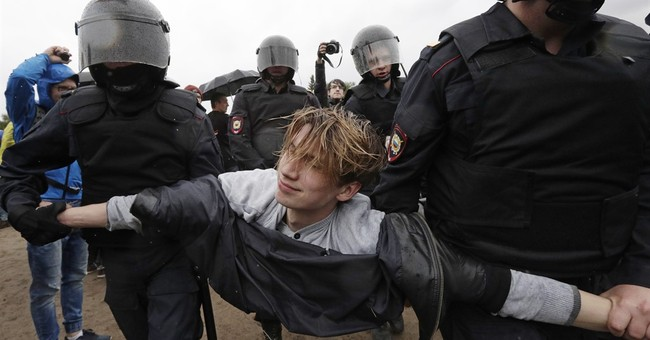 The Latest: Group: 1,750 arrested during Russia protest