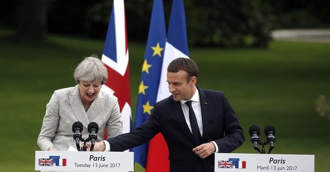 Lady Brexit meets Monsieur Europe: May, Macron hold talks