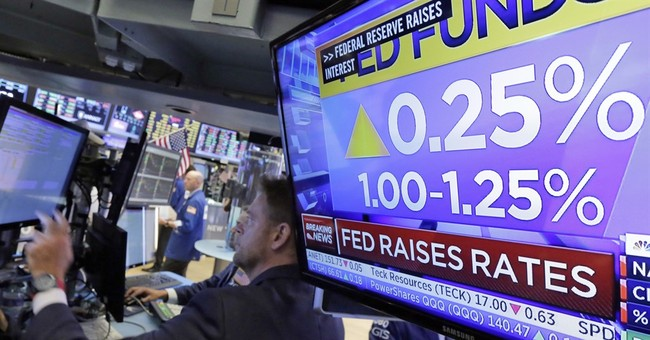 Asian shares fall after Fed rate hike, tracking Wall St lead