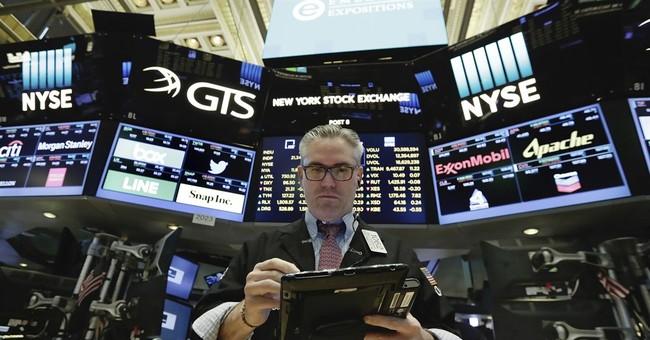 Economy Watch: Fed Sure of Economy, Raises Rates, Promises Asset Sell-Off