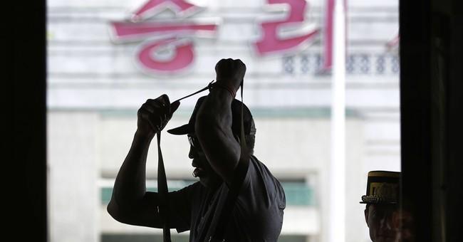Rodman's N. Korea trip off to uncharacteristic low-key start