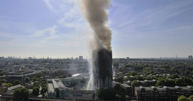 The Latest: Londoners help fire survivors with food, clothes
