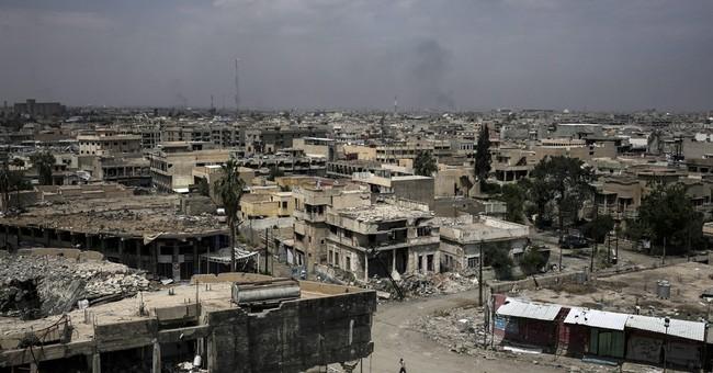 Messy fight awaits IS' next Syrian capital at Mayadeen