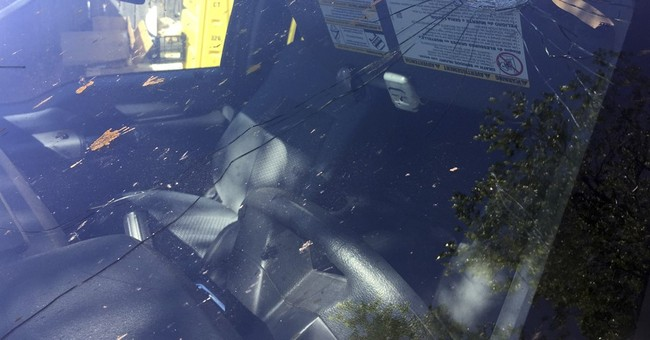 New Mexico land official finds bullet hole in windshield