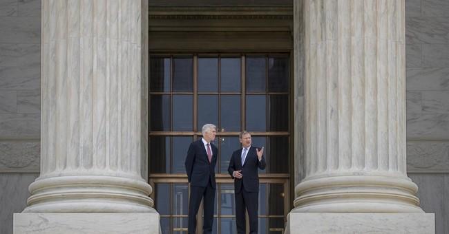 The Latest: Trump attends Gorsuch Supreme Court ceremony