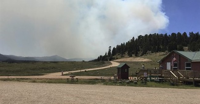 The Latest: Federal funds to help fight fire in New Mexico