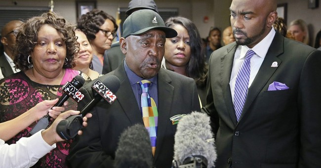 Family of Tulsa black man shot and killed by cop files suit