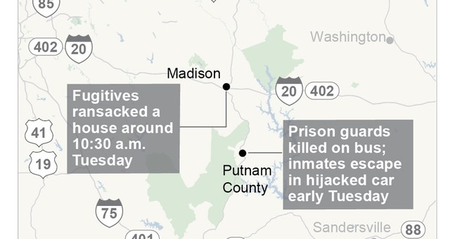 The Latest: Officials: Homeowner held inmates at gunpoint