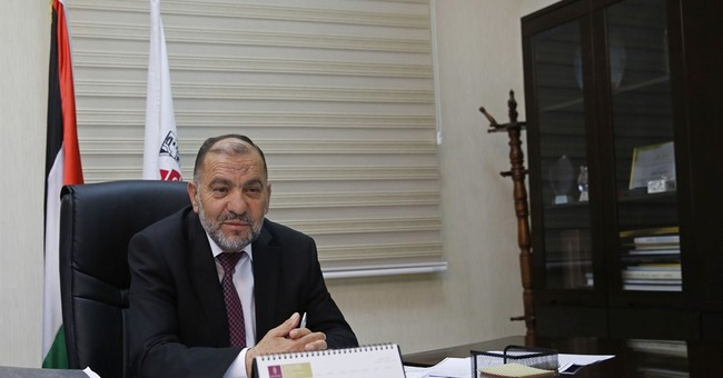 Palestinian mayor in West Bank brushes off his violent past