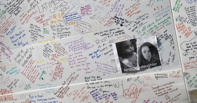 Probes launched amid grim search for London fire victims