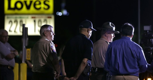 The Latest: Hostages' 911 call alerted police to fugitives