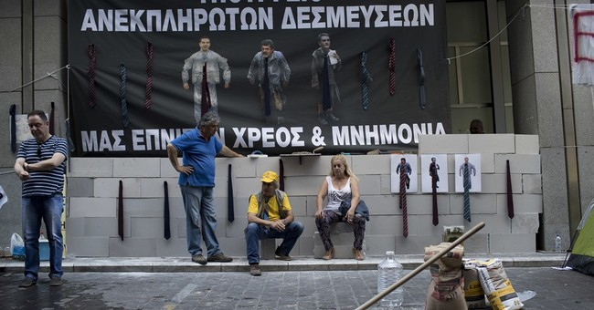 Greece dodges new crisis but austerity remains part of life