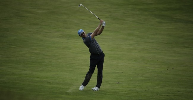 The Latest: Fleetwood, Harman trade birdies at 15 at US Open