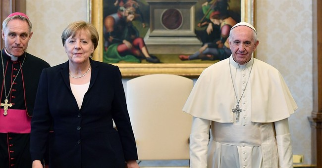Merkel: Pope wants her to fight to save Paris climate deal