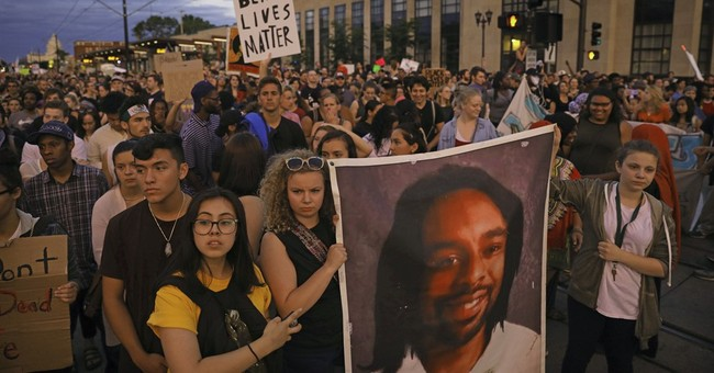 The Latest: 150 gather at Minnesota park for Castile rally