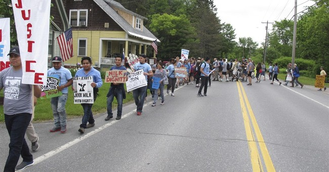 Scores of farm workers, activists march on Ben & Jerry's