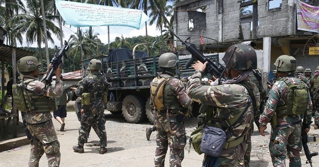 Philippines eyes truce with communist rebels amid siege