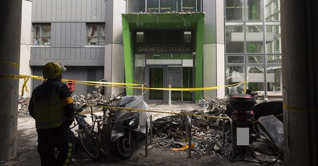 The Latest: London police show photos from inside fire tower