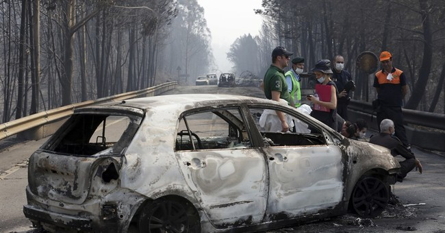The Latest: Portugal raises death toll back to 62