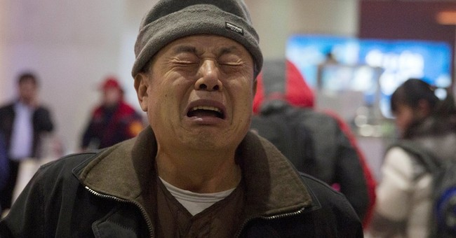 Flight 370 victims' families angry, resigned as search ends
