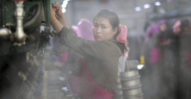 Silk, steam and slogans: Inside a North Korean factory