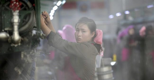 Silk, steam and slogans: Inside a North Korean factory