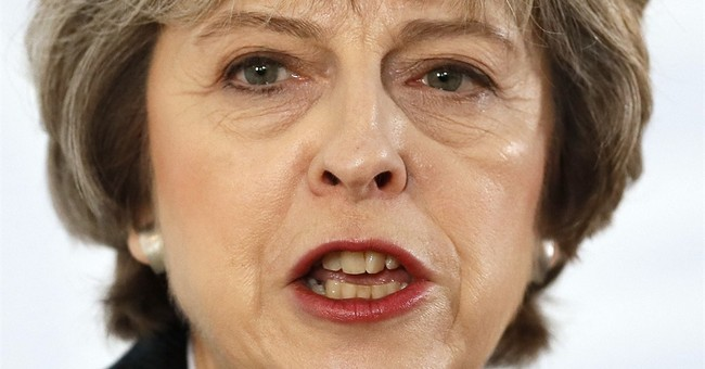 Markets cheer, EU wary as UK PM May signals 'clean Brexit'