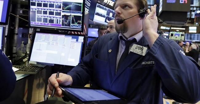 World stocks turn lower as investors monitor volatile dollar