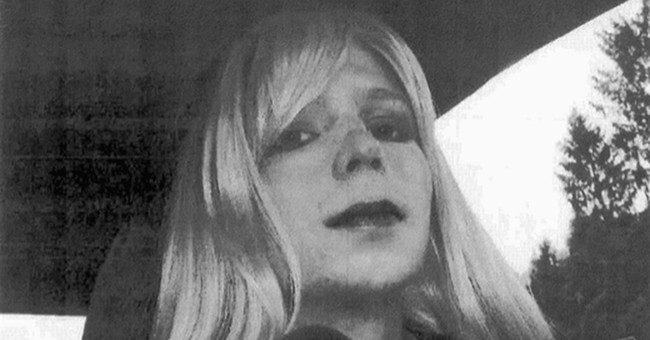 Obama shortens Manning's term, grants clemency to hundreds