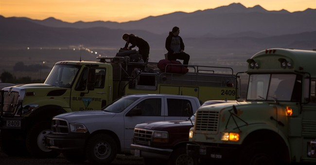 The Latest: Utah governor: Weed torch set fire near ski town