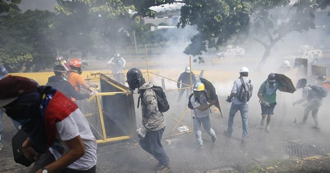 Venezuela walks out of Americas summit in Mexico
