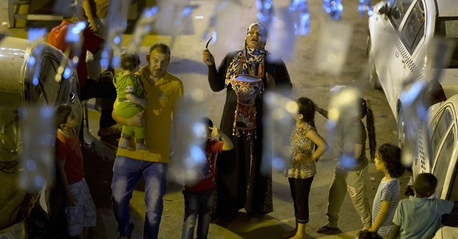 AP PHOTOS: Egypt woman gives wake-up call to Ramadan fasters