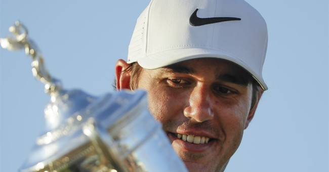 Long road: Koepka's journey now includes a US Open title