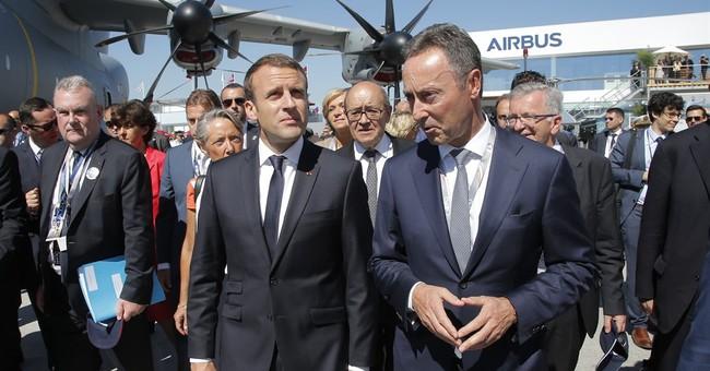 Macron kicks off Paris Air Show with airborne entrance