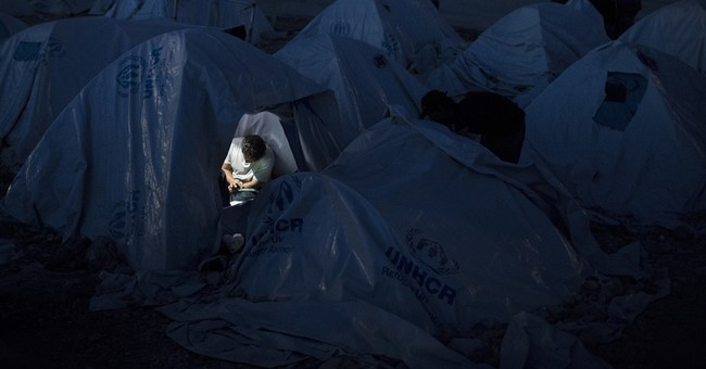 AP PHOTOS: Refugees, migrants stranded in limbo in Greece