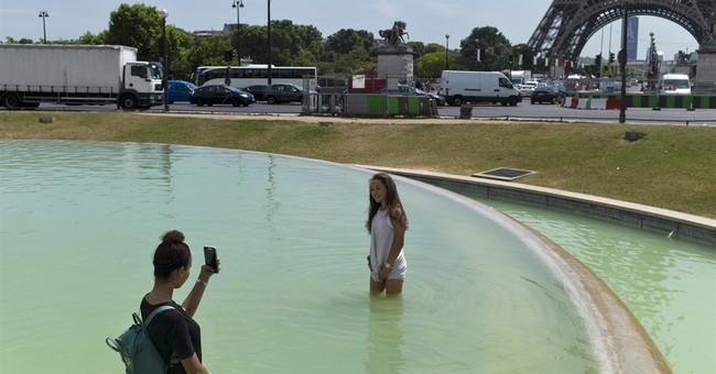France swelters under heatwave more typical of high summer