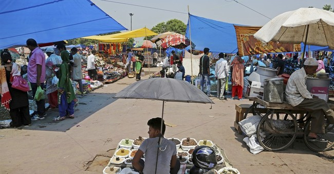 Shopkeepers rush to comply as India switches to single tax