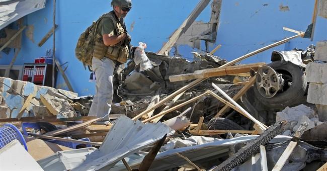 Car bomb in Somalia capital kills at least 15, police say