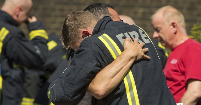 Adele visits London firefighters after tower block blaze