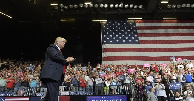In Iowa, boisterous Trump turns back the clock to campaign