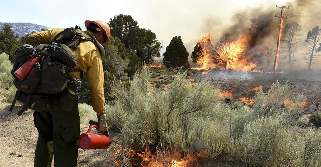 Extreme heat making wildfire battle tougher in Southwest US