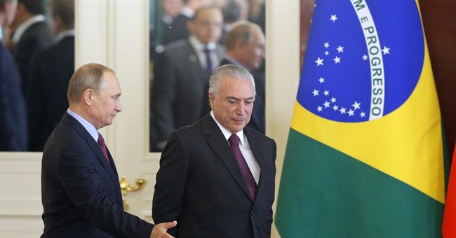 Brazilian president says he built warm ties with Putin