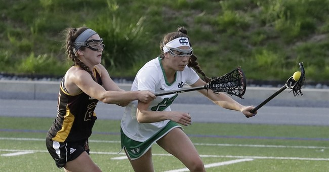 Debate stirs about female lax players not wearing helmets