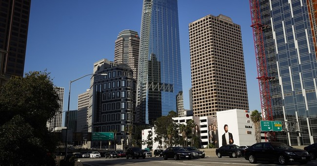 The Latest: Tallest building west of Mississippi River open