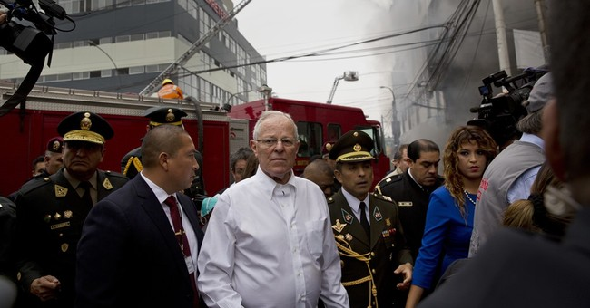 Anguish as trapped workers call for help in Peru fire