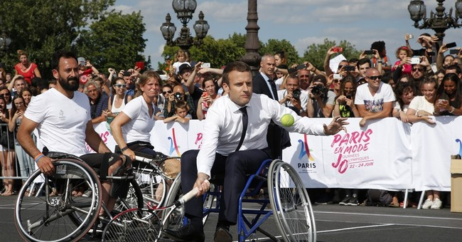 Macron promotes Paris 2024 Olympic bid playing tennis