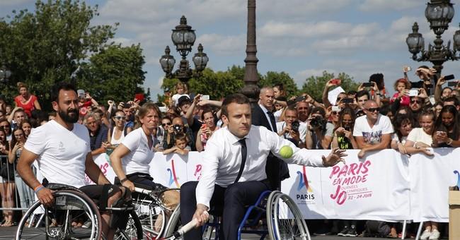 Macron promotes Paris 2024 Olympic bid playing tennis