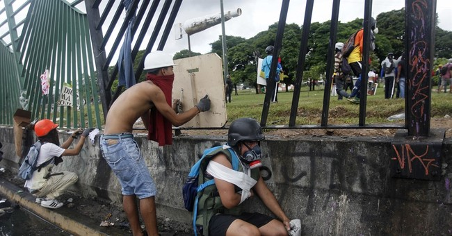 Venezuelan protesters, security forces clash at air base