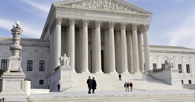The Latest: Supreme Court orders re-argument in 2 cases