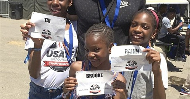 Once-homeless sisters mingle with track stars at nationals